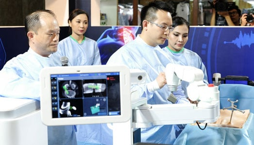 Robotic-Assisted and Navigated Spine Surgery